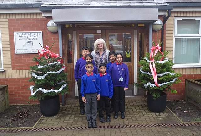Mrs Pursey is pictured with St Hildas' junior management team and eco council