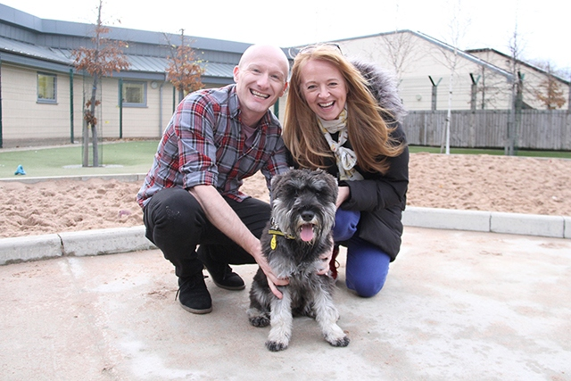 Sally Ann and Adam are pictured with miniature Schnauzer, Paddy