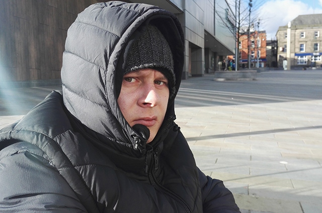 Matthew, a rough sleeper, regularly sits outside the new cinema complex in central Oldham
