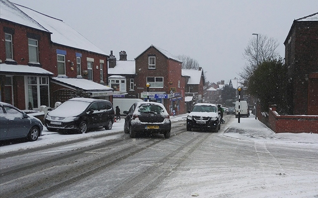 The snowy traffic scene in Coppice this morning