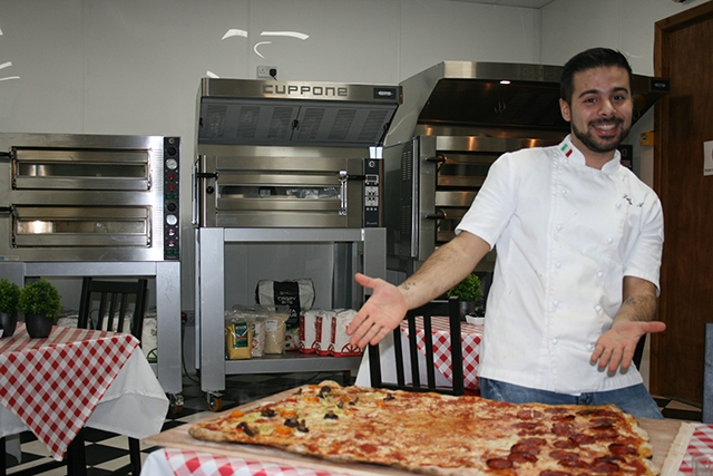 Have a go at the charity Pizza Challenge at Linda Lewis Kitchens' Oldham base. Pictured is chef Fabio Aurelio.