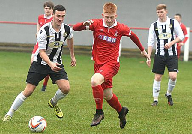 Aaron Scholes (centre) notched a late point-saver for Chadderton