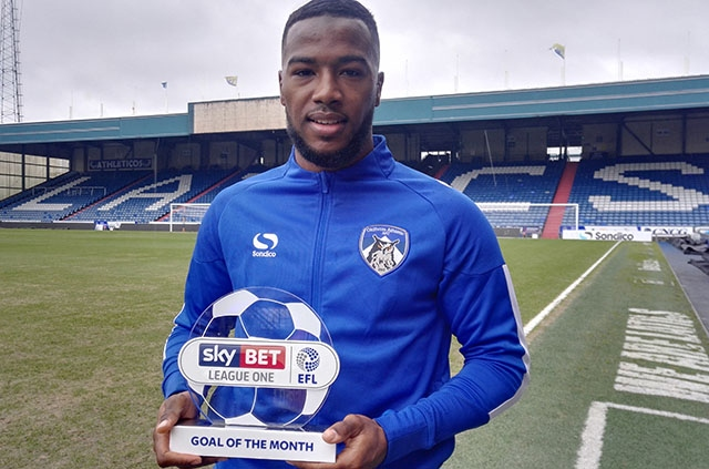 EFL Goal of the Month winner Duckens Nazon proudly shows off his award