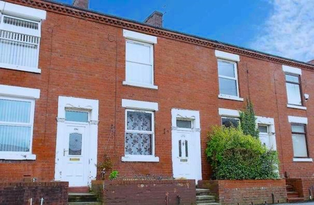 The four-bedroom property on Garforth Street in Chadderton