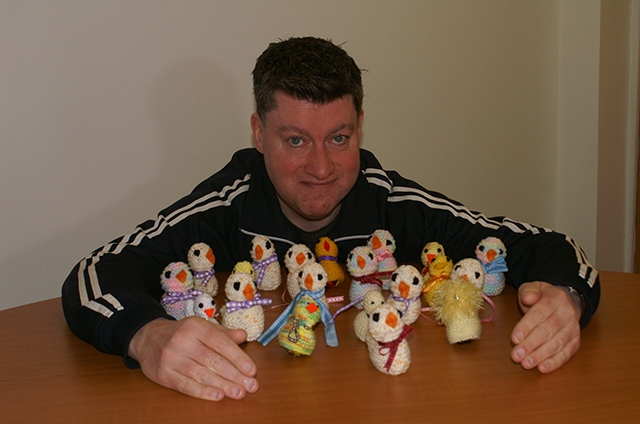 Patrick Scrivens, from the Town Barber Too, with some Easter Chicks