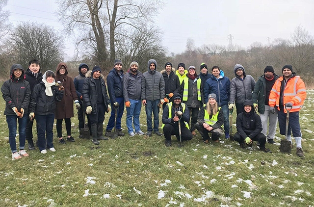 Young Ahmadi Muslims from Oldham dug in to plant trees as part of the increasingly popular 'City of Trees' initiative.