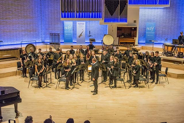 The Oldham Youth Wind Band on stage at the Royal Northern College of Music