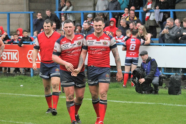 The defeated Oldham players gave it their best shot against Hull KR.