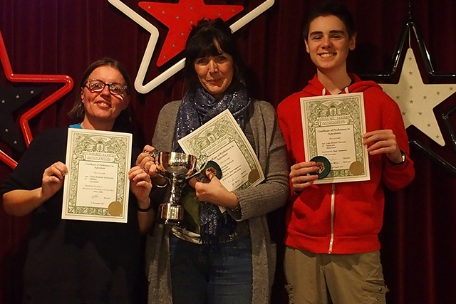 Catherine Charnock, her son Luke, and Diane Drinkwater show off their beekeeping awards