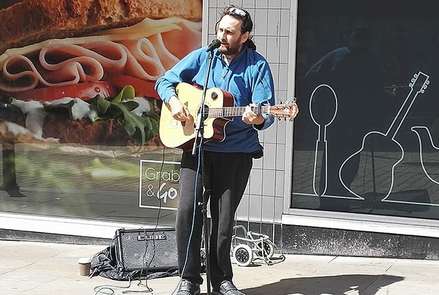 Dave struts his stuff outside Home Bargains in Oldham town centre