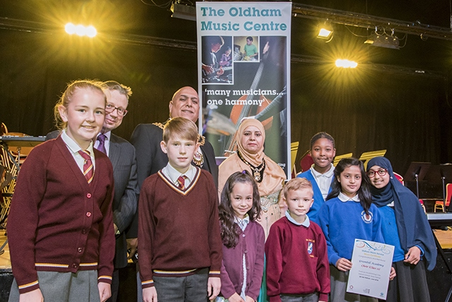 Pictured are Mayor of Oldham Javid Iqbal and Mayoress of Oldham Tasleem Akhtar with young musicians who performed at the festival