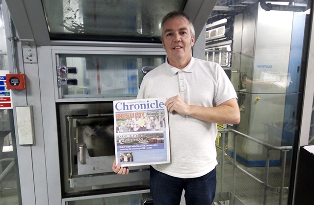 Oldham Chronicle Open Days supplement editor Simon Smedley picks up an edition hot off the press yesterday