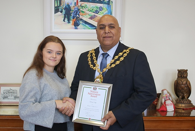 Ashleigh receiving her award from the Mayor of Oldham Councillor Javid Iqbal
