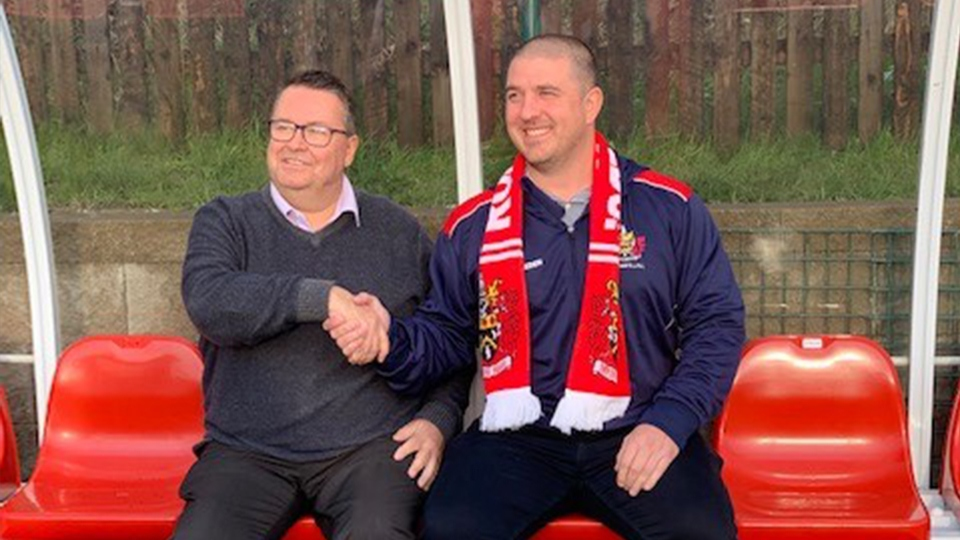 In the Vestacare Stadium hot-seat for the first time . . . Matt Diskin (right) with club chairman Chris Hamilton.