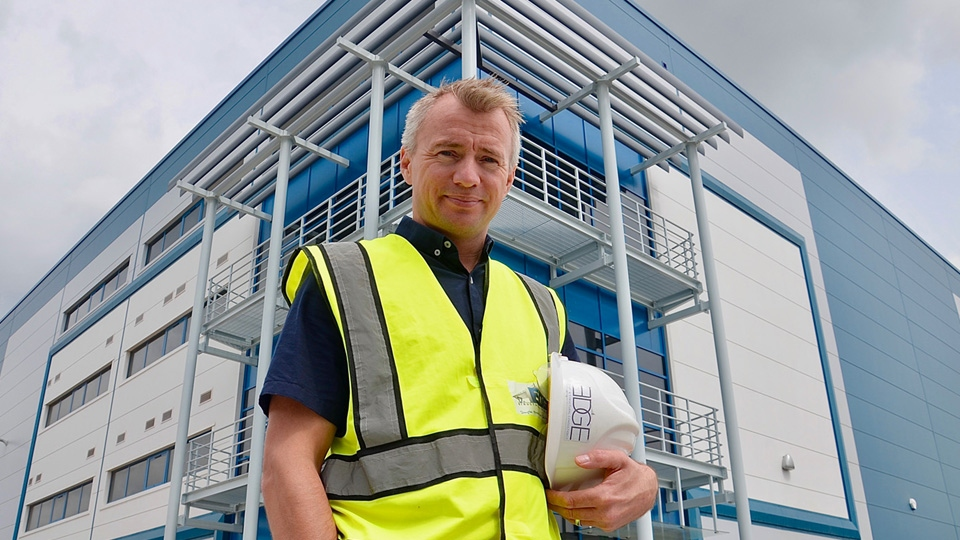 Adam Sedgwick of Edge Structural Design at Haydock Green in front of balcony steelwork at the warehouse reception.