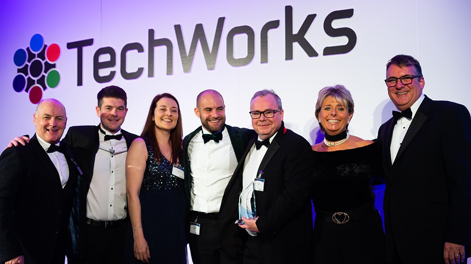 Mick Conlon (holding trophy) and colleagues receive the 2019 TechWorks Manufacturing Site of the Year Award for Diodes Incorporated (Oldham) - alongside compere Penny Power OBE and Techworks CEO, Alan Banks (right) and John Summers and Dominic Flynn of sponsor Logos Logistics