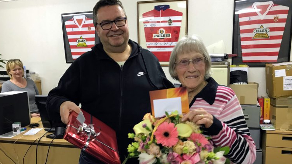 Clarice pictured with Roughyeds chairman Chris Hamilton at her surprise 90th birthday party at the club.