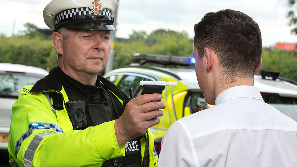 GMP officer carrying out a breath test