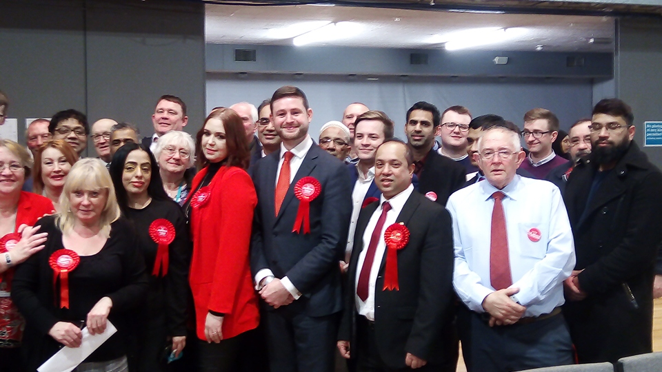Re-elected MP Jim McMahon and his team