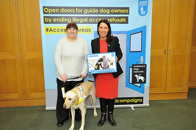MP Debbie Abrahams met Laura with her guide dog Jimmy, who is a yellow Labrador retriever, at a special launch of Guide Dogs' Access All Areas campaign in Parliament