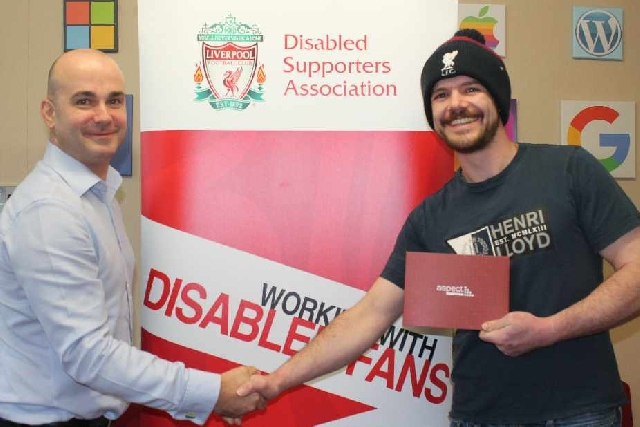 Oldham business gives Liverpool FC Disabled Supporters Association a boost