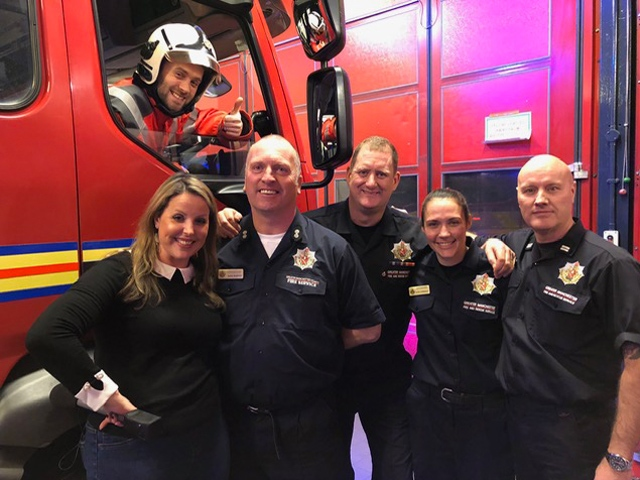 Chef Adam Reid with presenter Vicky Grimes, Watch Manager Mark Bamford, Firefighter Pete Griffiths, Firefighter Kate Lonsdale and Crew Manager Dave Dodson