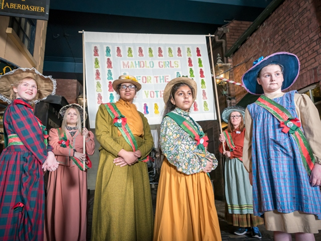 Young people who are taking part in the Game Changers project who visited Salford Museum to dress as suffragists for inspiration
