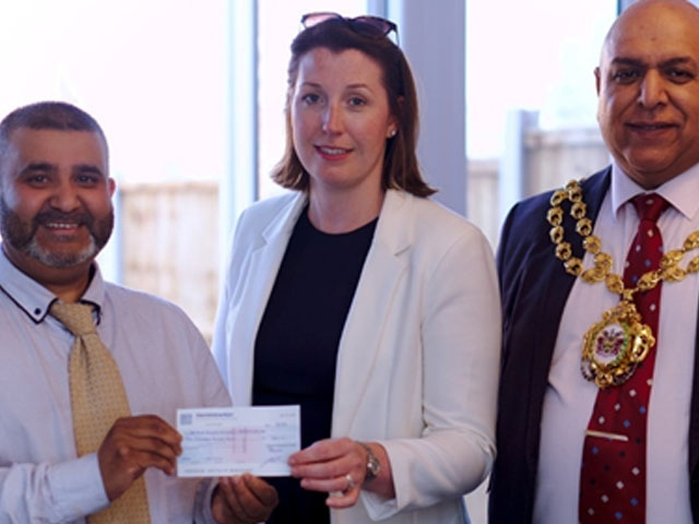 Maruf Ali from SPARC, Jenn Sutton from Wiggett Homes and the Mayor of Oldham, Councillor Javid Iqbal.