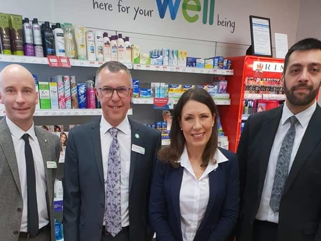 Debbie Abrahams with staff at Well Pharmacy Uppermill