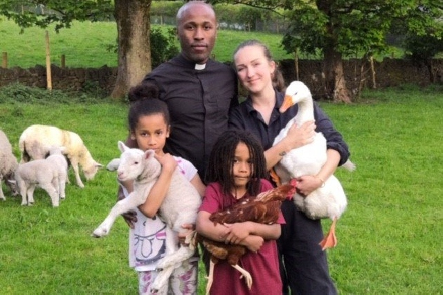 Rev Jackman abd his wife Gemma are pictured with  Hope, holding Dobby the Lamb,  Abraham holding Zoe the Hen, and Mrs Jackman is  holding the goose  Little Richard