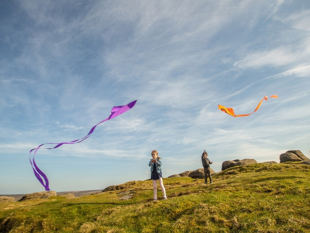 Children fly kites on a sunny day in the South Pennines. Pic courtesy of Craig Shaw.