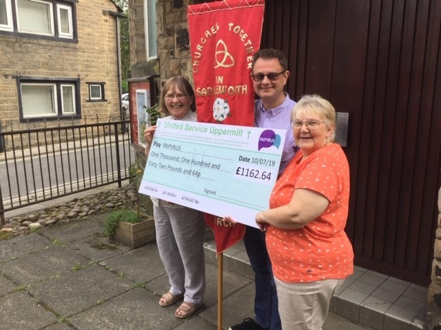 Cheque mates: Pictured are Rev Audrey Lee and Hilary Yates from Ebenezer, and Adrian Green of Uppermill Methodist Church