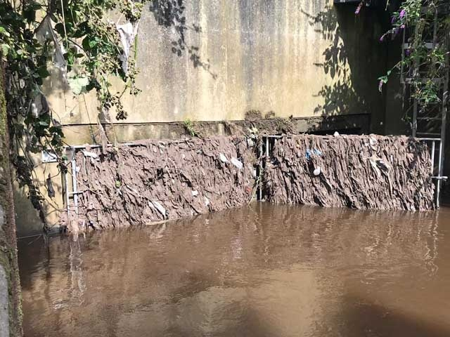 Wet wipes block a sewer overflow at the River Tame in Stockport