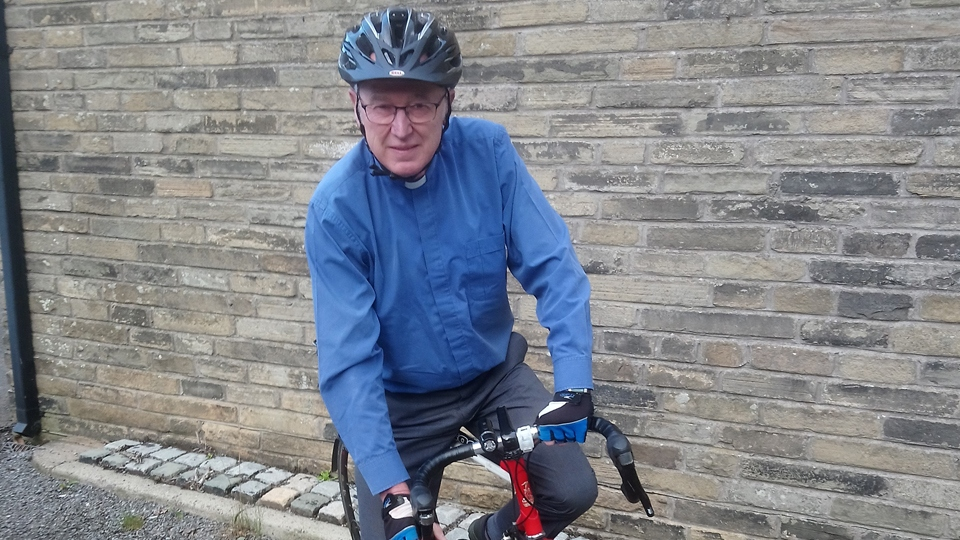 Rev John Rosedale on his bike