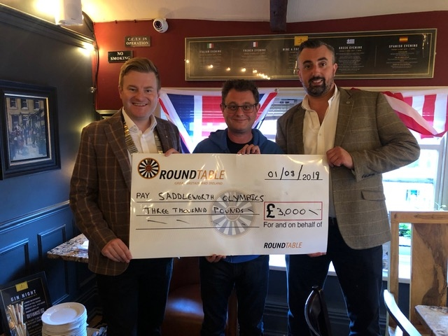 Cheque mates: Pictured (left to right) are Andrew Rothwell, chairman of Saddleworth Round Table, Adrian Green, chair of Saddleworth Village Olympics, and Matthew Sykes, Table's community support officer