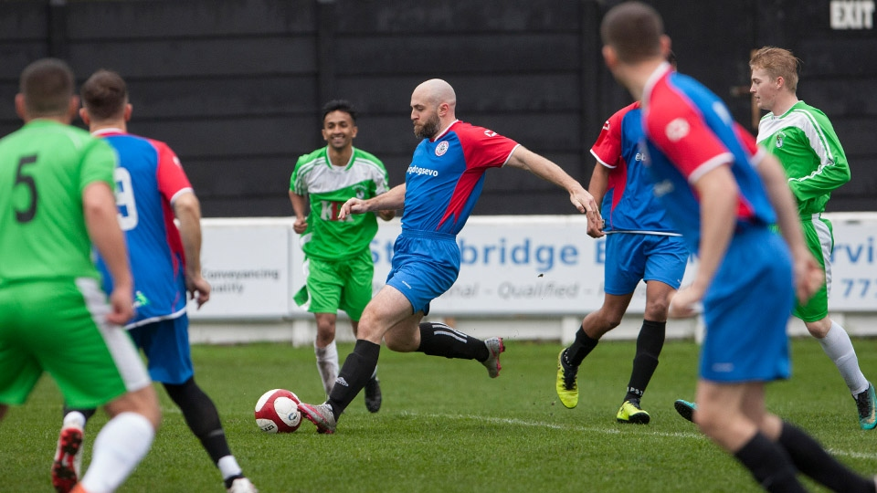Players compete in last year's Emmaus Mossley vs GMP charity match