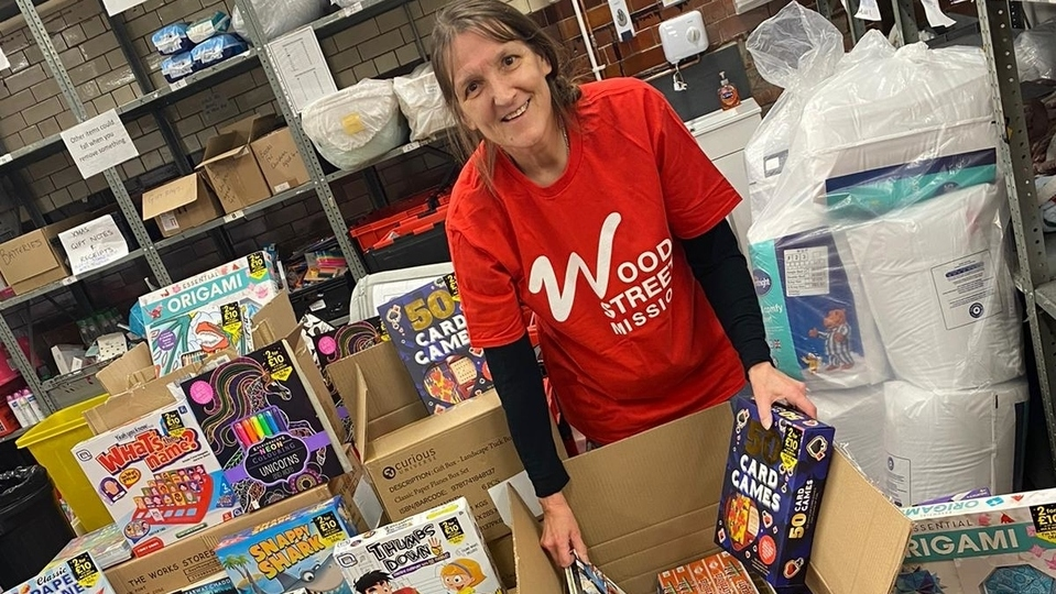 A Wood Street Mission volunteer is pictured with some of the Swansway donations