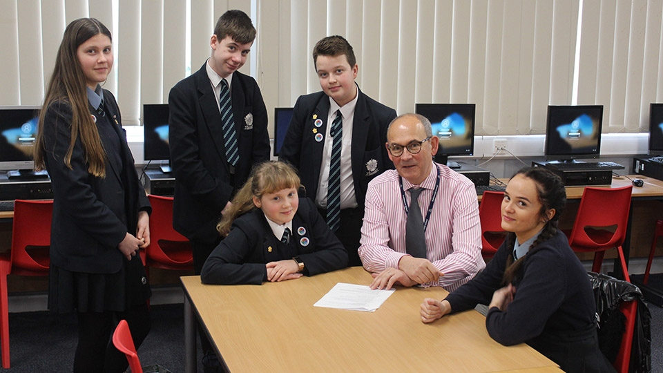 Saddleworth school executive headmaster Matthew Milburn with some of his senior students.