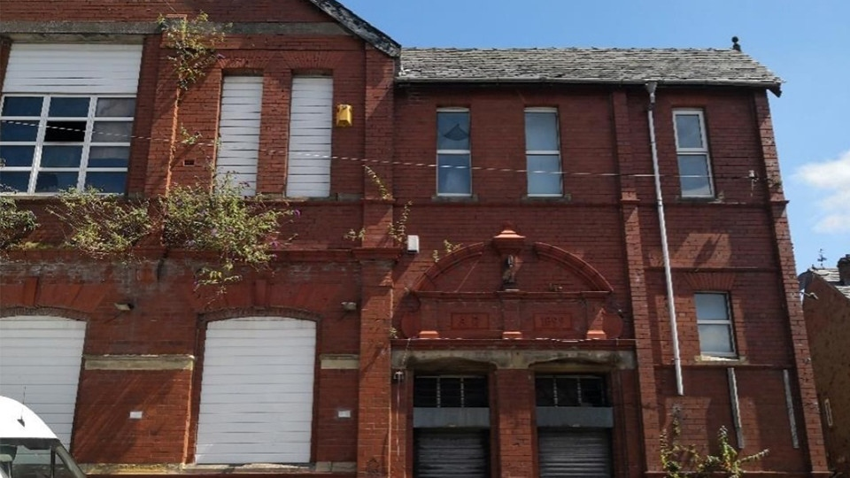 A former Conservative club and shops in Oldham will be transformed into shared houses, with up to 18 people living in one building.