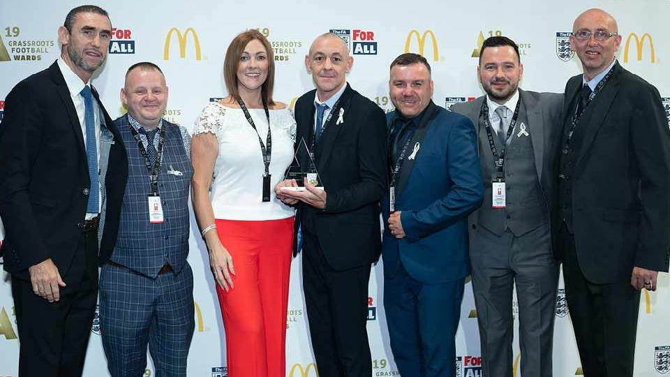 FOLLO FC officials pictured at last year's awards bash with Martin Keown