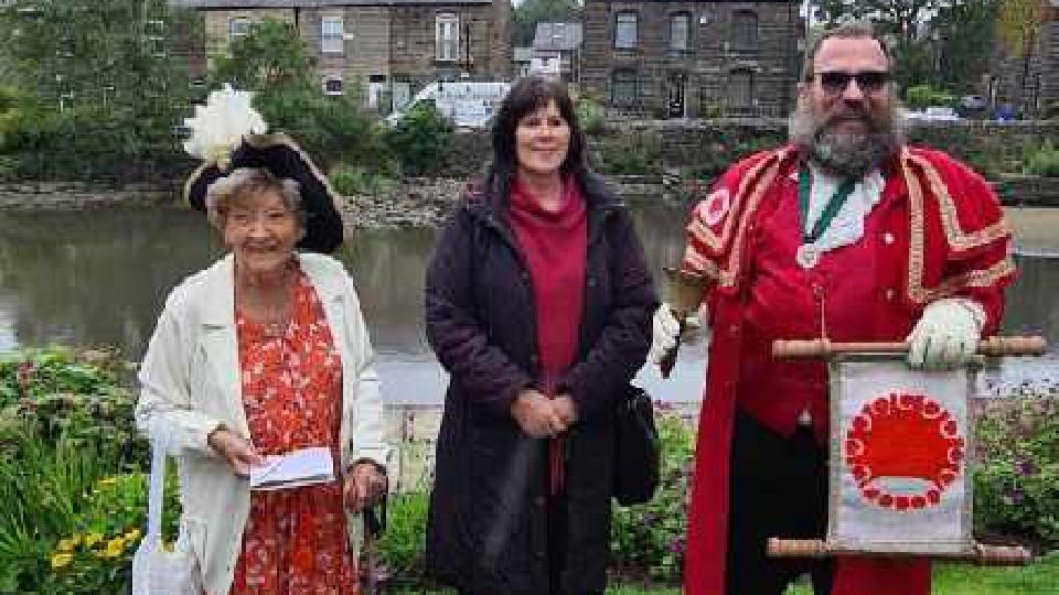 Annie Schofield is pictured with Town Crier, Marcus Emms, and Mayor of Oldham, Cllr Ginny Alexander