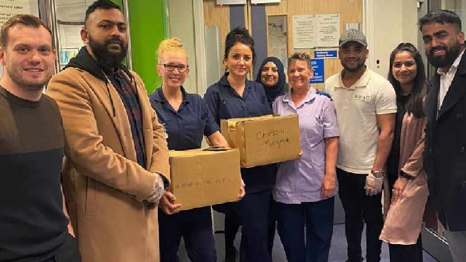 Pictured are the team from the Khau Galli delivering food to the Royal Oldham Hospital's Accident and Emergency department