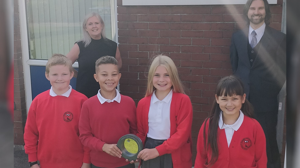 Staff and pupils at Knowsley Junior School with their award