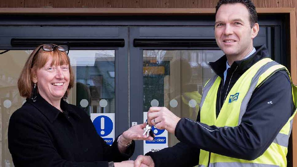 Zoe Thompson, Proprietor and Head of Development, receives the keys to the new Bright Futures School site from Daniel Scott, Operations Director at Robert Scotts