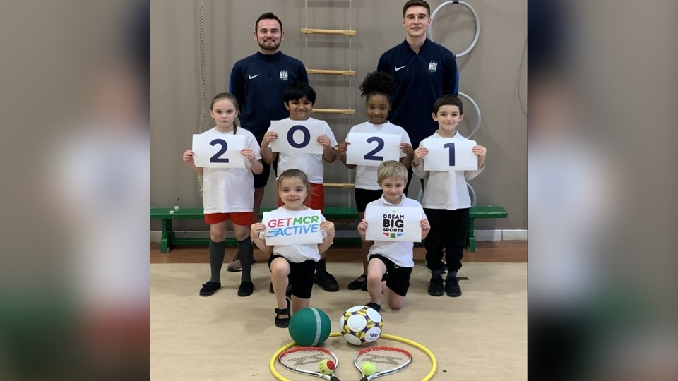 Jack Kendall (Operations Manager, back left) and Lewis Bradley (Primary PE Specialist) with students from a Dream Big Sports group