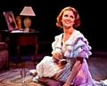 Laura (Katie Moore) in a moment of happiness in Tennessee Williams's The Glass Menagerie