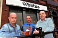 CHEERS . . . the new owners of Whittles, from left, John Dodd, Martin Schofield and Neil Haughton