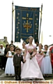 Rose Queen Melissa Taylor, from St Thomas�s in Lees, accompanied by her retinue and Lukas Briggs