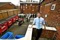 OUTDOOR plans... Shay Wake deputy manager Simon Briggs in the yard the pub wants to turn into a beer garden