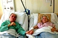 TOGETHER again . . . nursing staff are making sure Derek and Gladys Pye get to see each other regularly while they recover